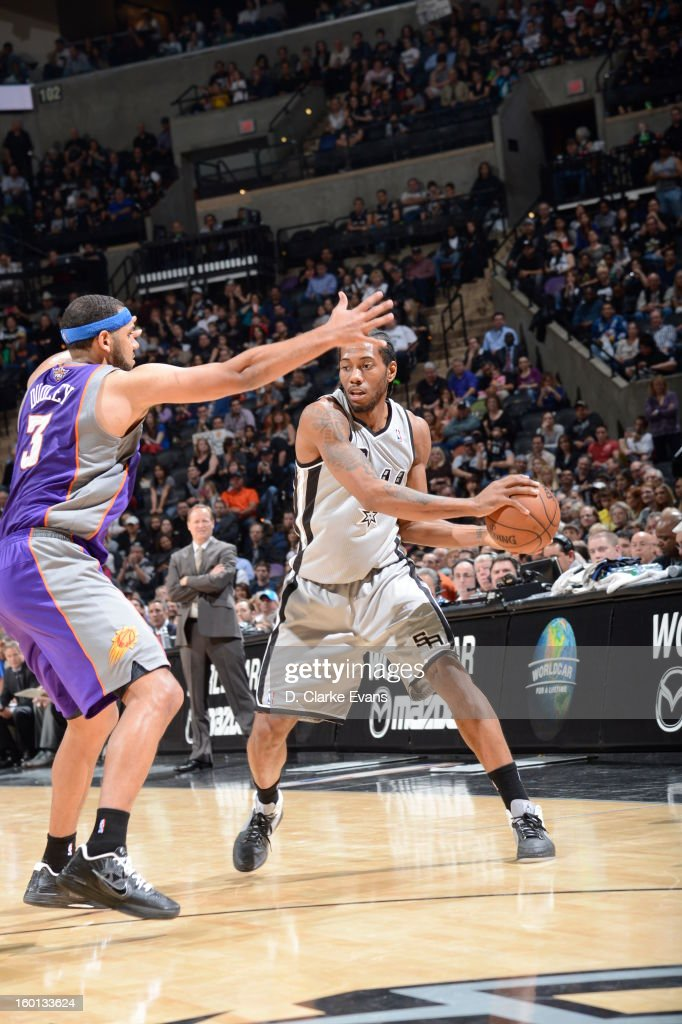 Kawhi Leonard #2 of the San Antonio Spurs looks to pass the ball against Jared Dudley #3 of the Phoenix Suns on January 26, 2013 at the AT&T Center in San Antonio, Texas.