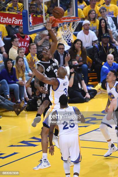 Kawhi Leonard of the San Antonio Spurs makes a shot against the Golden State Warriors during Game One of the NBA Western Conference Finals at ORACLE...
