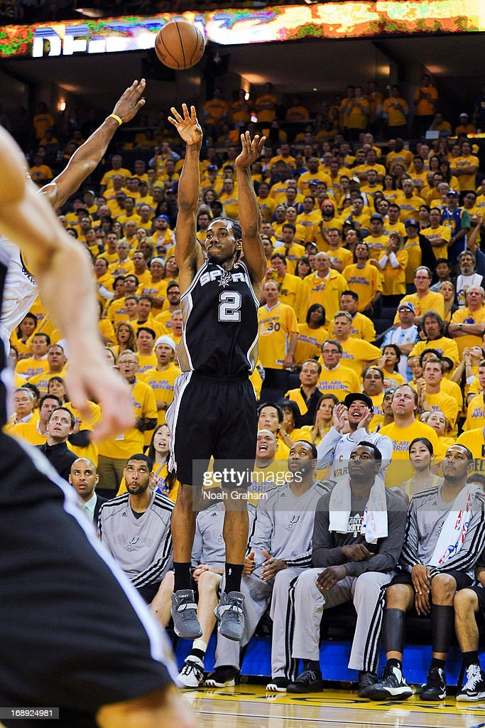 Kawhi Leonard #2 of the San Antonio Spurs makes a three-pointer late in the fourth quarter against the Golden State Warriors in Game Six of the Western Conference Semifinals during the 2013 NBA Playoffs on May 16, 2013 at Oracle Arena in Oakland, California.
