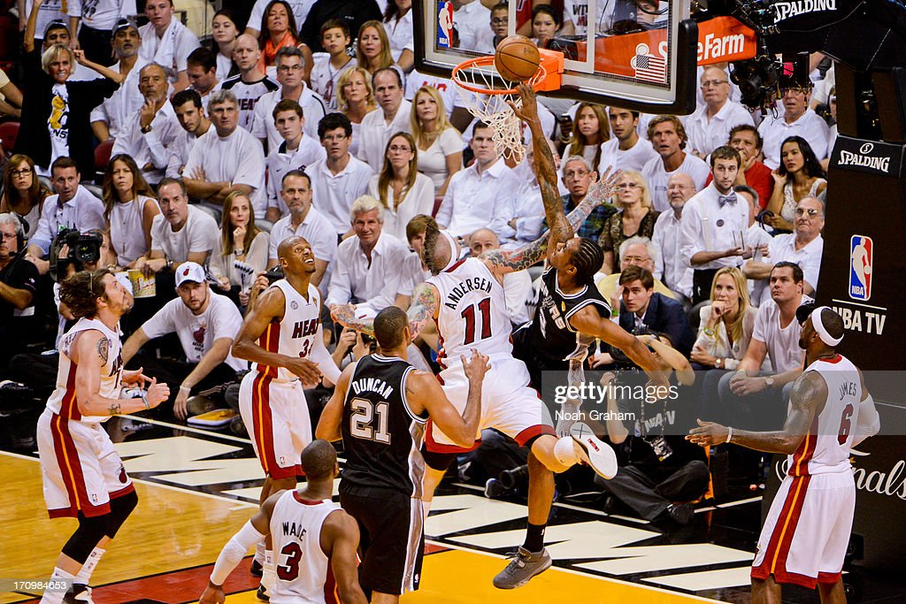 Kawhi Leonard #2 of the San Antonio Spurs misses a dunk attempt against Chris Andersen #11 of the Miami Heat during Game Seven of the 2013 NBA Finals on June 20, 2013 at American Airlines Arena in Miami, Florida.