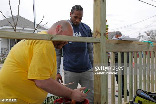 Kawhi Leonard of the San Antonio Spurs participate during the NBA Cares Day of Service as part of 2017 AllStar Weekend at the KaBOOM Rebuilding...