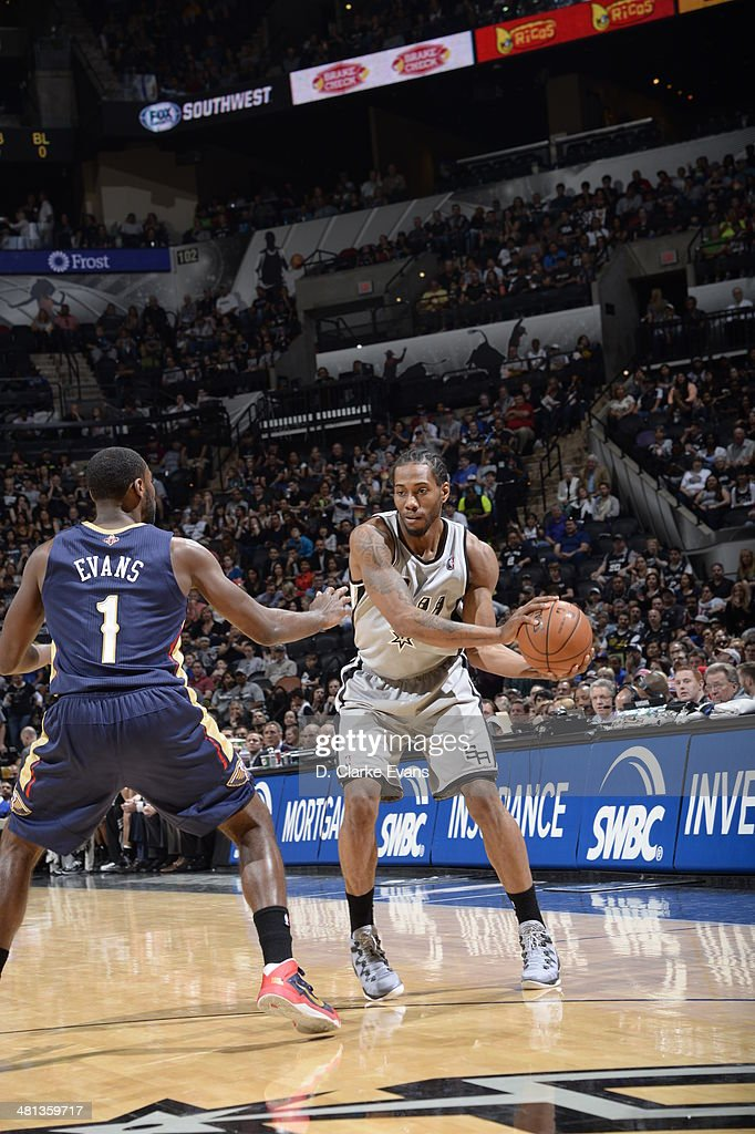 Kawhi Leonard #2 of the San Antonio Spurs passes the ball against Tyreke Evans #1 of the New Orleans Pelicans at the AT&T Center on March 29, 2014 in San Antonio, Texas.
