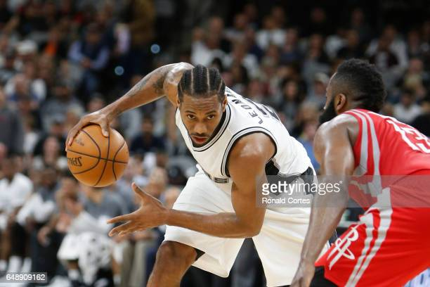 Kawhi Leonard of the San Antonio Spurs prepares to drive on James Harden of the Houston Rockets at ATT Center on March 6 2017 in San Antonio Texas...
