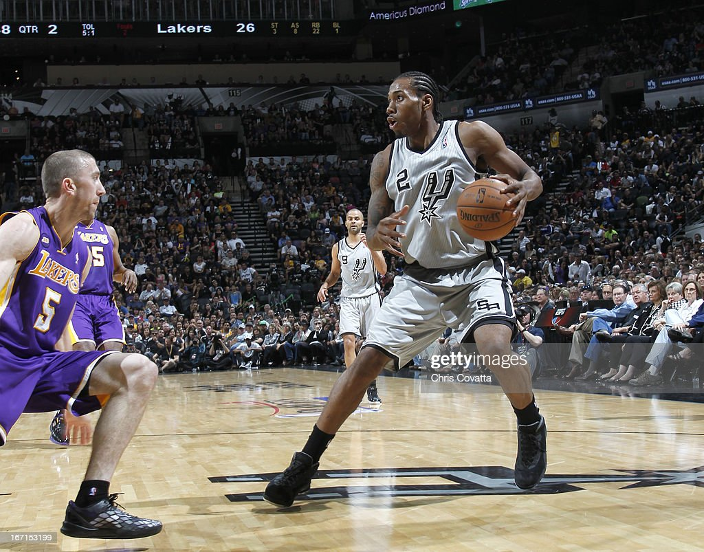 Kawhi Leonard #2 of the San Antonio Spurs protects the ball from Steve Blake #5 of the Los Angeles Lakers during the Game One of the Western Conference Quarterfinals between the Los Angeles Lakers and the San Antonio Spurs on April 21, 2013 at the AT&T Center in San Antonio, Texas.