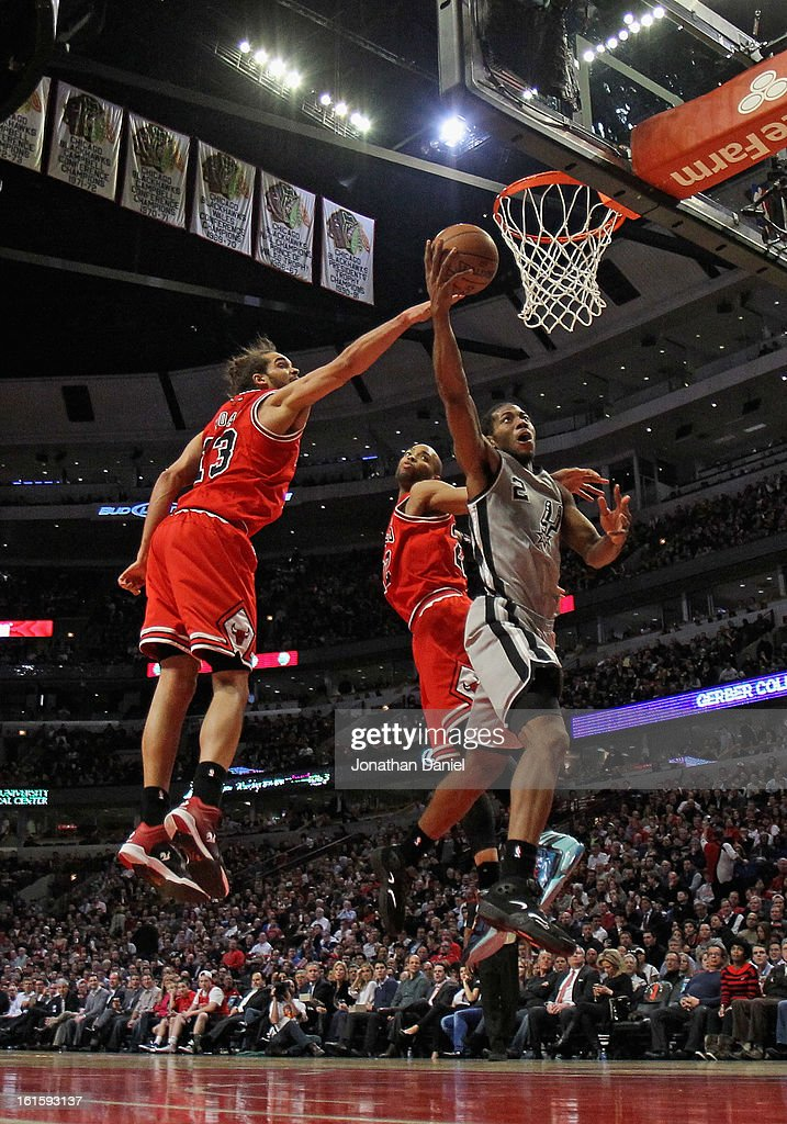 Kawhi Leonard #2 of the San Antonio Spurs puts up a shot past Joakim Noah #13 and Taj Gibson #22 of the Chicago Bulls on his way to a game high 26 points at the United Center on February 11, 2013 in Chicago, Illinois. The Spurs defeated the Bulls 103-89.