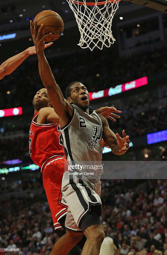Kawhi Leonard #2 of the San Antonio Spurs puts up a shot past Taj Gibson #22 of the Chicago Bulls on his way to a game high 26 points at the United Center on February 11, 2013 in Chicago, Illinois. The Spurs defeated the Bulls 103-89.