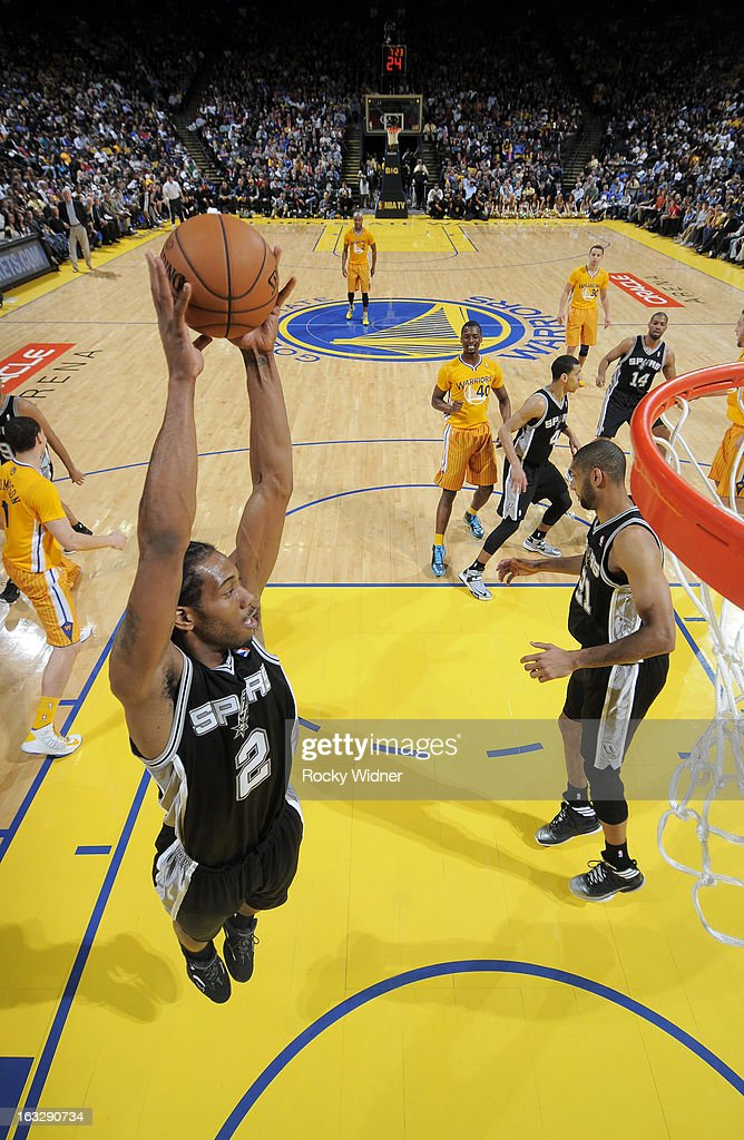 Kawhi Leonard #2 of the San Antonio Spurs rebounds against the Golden State Warriors on February 22, 2013 at Oracle Arena in Oakland, California.