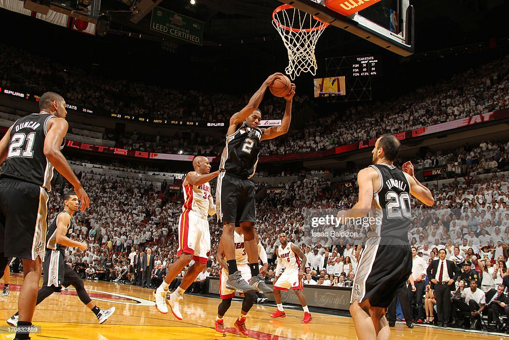 Kawhi Leonard #2 of the San Antonio Spurs rebounds during Game Six of the 2013 NBA Finals between the Miami Heat and the San Antonio Spurs on June 18, 2013 at American Airlines Arena in Miami, Florida.
