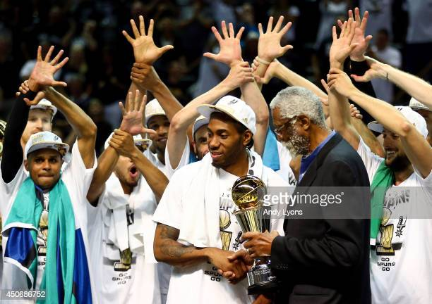 Kawhi Leonard of the San Antonio Spurs recieves the Bill Russell NBA Finals Most Valuable Player Award from NBA Legend Bill Russell after defeating...