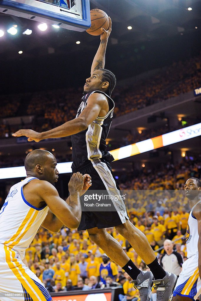 Kawhi Leonard #2 of the San Antonio Spurs rises for a dunk against Carl Landry #7 of the Golden State Warriors in Game Six of the Western Conference Semifinals during the 2013 NBA Playoffs on May 16, 2013 at Oracle Arena in Oakland, California.