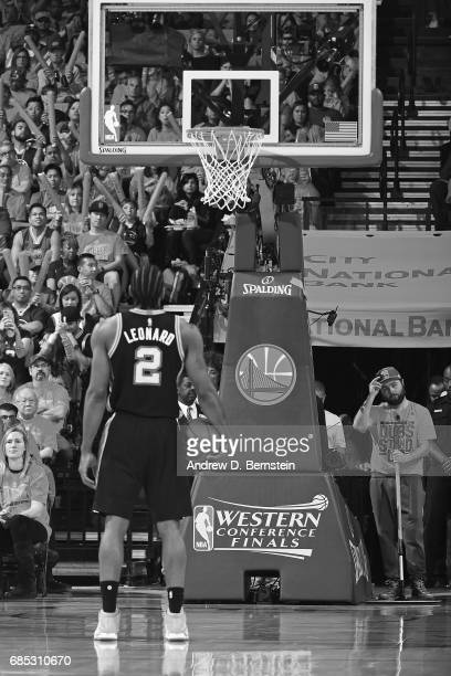 Kawhi Leonard of the San Antonio Spurs shoots a foul shot in Game One of the Western Conference Finals against the Golden State Warriors during the...