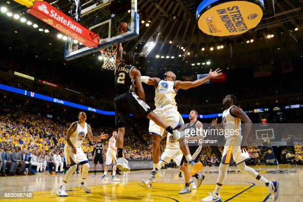 Kawhi Leonard of the San Antonio Spurs shoots a lay up during the game against the Golden State Warriors during Game One of the Western Conference...