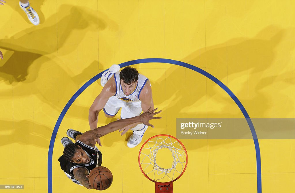 Kawhi Leonard #2 of the San Antonio Spurs shoots a layup against Andrew Bogut #12 of the Golden State Warriors in Game Six of the Western Conference Semifinals during the 2013 NBA Playoffs on May 16, 2013 at Oracle Arena in Oakland, California.