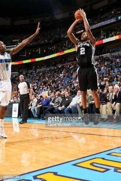 Kawhi Leonard of the San Antonio Spurs shoots a threepointer against the New Orleans Hornets on January 7 2013 at the New Orleans Arena in New...