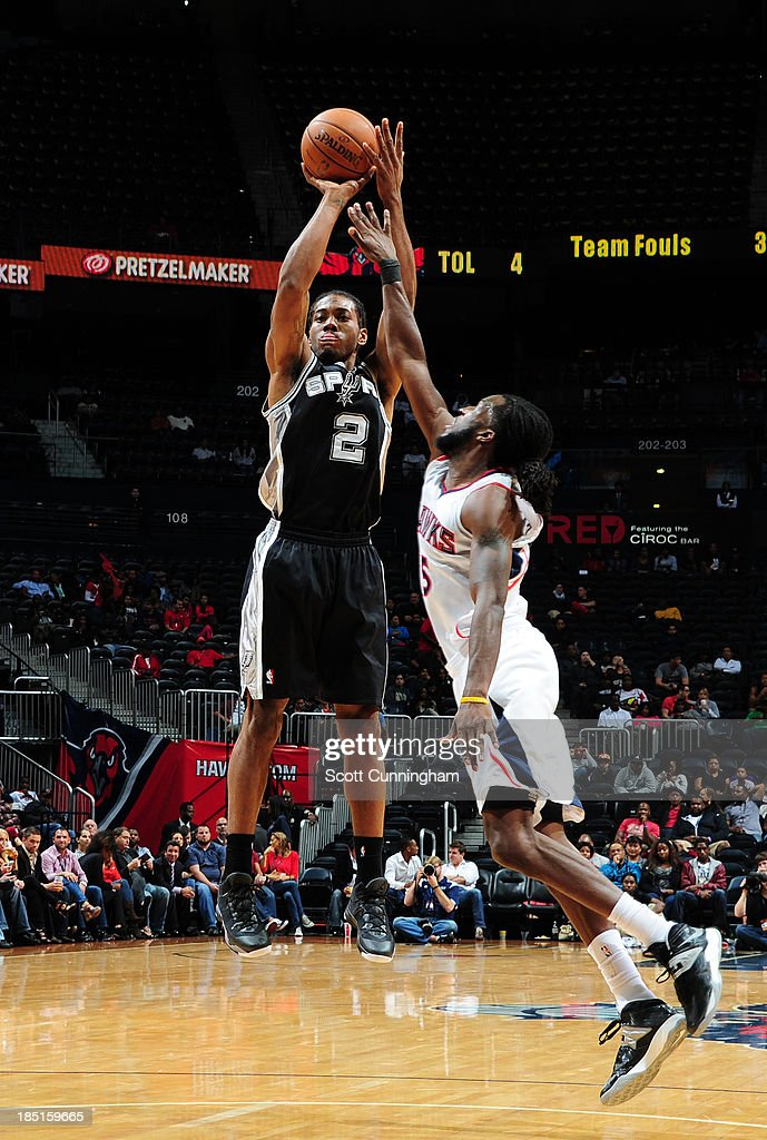 <a gi-track='captionPersonalityLinkClicked' href=/galleries/search?phrase=Kawhi+Leonard&family=editorial&specificpeople=6691012 ng-click='$event.stopPropagation()'>Kawhi Leonard</a> #2 of the San Antonio Spurs shoots against <a gi-track='captionPersonalityLinkClicked' href=/galleries/search?phrase=DeMarre+Carroll&family=editorial&specificpeople=784686 ng-click='$event.stopPropagation()'>DeMarre Carroll</a> #5 of the Atlanta Hawks on October 17, 2013 at Philips Arena in Atlanta, Georgia.