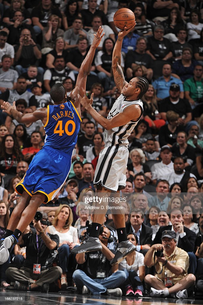 Kawhi Leonard #2 of the San Antonio Spurs shoots against Harrison Barnes #40 of the Golden State Warriors in Game One of the Western Conference Semifinals during the 2013 NBA Playoffs on May 6, 2013 at the AT&T Center in San Antonio, Texas.