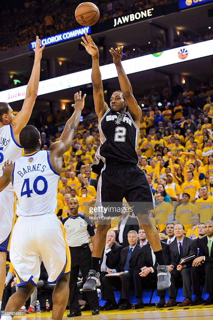 Kawhi Leonard #2 of the San Antonio Spurs shoots against Harrison Barnes #40 of the Golden State Warriors in Game Six of the Western Conference Semifinals during the 2013 NBA Playoffs on May 16, 2013 at Oracle Arena in Oakland, California.