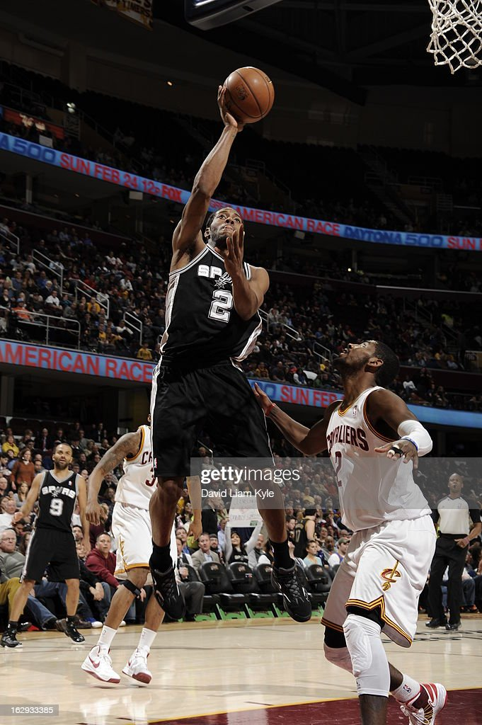 Kawhi Leonard #2 of the San Antonio Spurs shoots against Kyrie Irving #2 of the Cleveland Cavaliers at The Quicken Loans Arena on February 13, 2013 in Cleveland, Ohio.