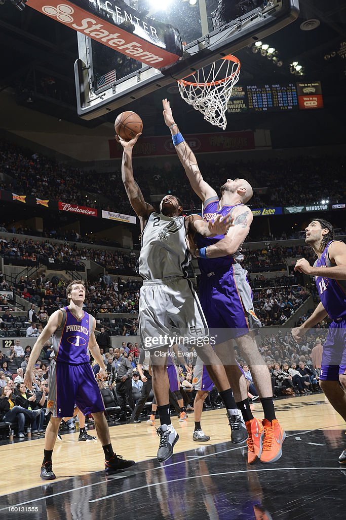 Kawhi Leonard #2 of the San Antonio Spurs shoots against Marcin Gortat #4 of the Phoenix Suns on January 26, 2013 at the AT&T Center in San Antonio, Texas.