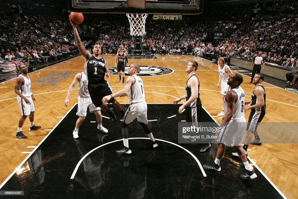 <a gi-track='captionPersonalityLinkClicked' href=/galleries/search?phrase=Kawhi+Leonard&family=editorial&specificpeople=6691012 ng-click='$event.stopPropagation()'>Kawhi Leonard</a> #2 of the San Antonio Spurs shoots against the Brooklyn Nets at the Barclays Center on February 06, 2014 in the Brooklyn borough of New York City.