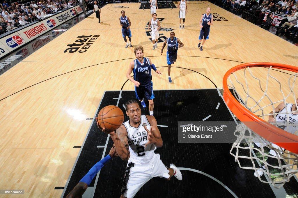 Kawhi Leonard #2 of the San Antonio Spurs shoots against the Dallas Mavericks on March 14, 2013 at the AT&T Center in San Antonio, Texas.