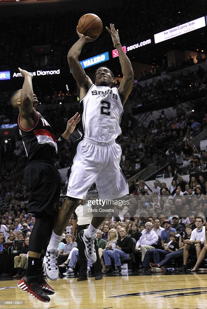 <a gi-track='captionPersonalityLinkClicked' href=/galleries/search?phrase=Kawhi+Leonard&family=editorial&specificpeople=6691012 ng-click='$event.stopPropagation()'>Kawhi Leonard</a> #2 of the San Antonio Spurs shoots against the Portland Trail Blazersin Game One of the Western Conference Semifinals during the 2014 NBA Playoffs at the AT&T Center on May 6, 2014 in San Antonio, Texas.