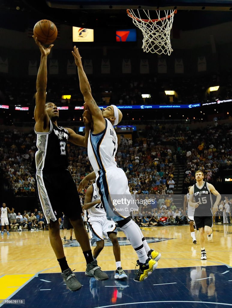 Kawhi Leonard #2 of the San Antonio Spurs shoots over Jerryd Bayless #7 of the Memphis Grizzlies in the second half during Game Four of the Western Conference Finals of the 2013 NBA Playoffs at the FedExForum on May 27, 2013 in Memphis, Tennessee.