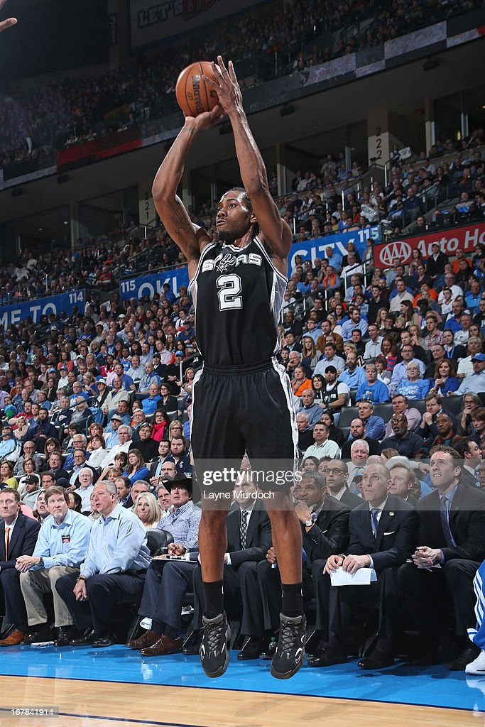 <a gi-track='captionPersonalityLinkClicked' href=/galleries/search?phrase=Kawhi+Leonard&family=editorial&specificpeople=6691012 ng-click='$event.stopPropagation()'>Kawhi Leonard</a> #2 of the San Antonio Spurs shoots the ball against the Oklahoma City Thunder on April 4, 2013 at the Chesapeake Energy Arena in Oklahoma City, Oklahoma.
