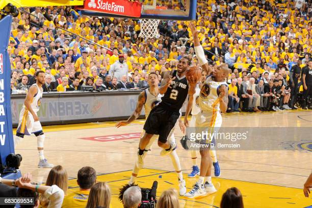 Kawhi Leonard of the San Antonio Spurs shoots the ball against the Golden State Warriors in Game One of the Western Conference Finals of the 2017 NBA...