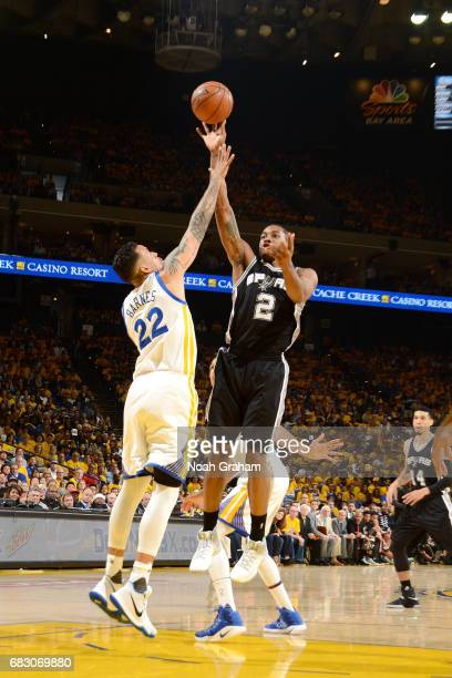 Kawhi Leonard of the San Antonio Spurs shoots the ball during the game against the Golden State Warriors during Game One of the Western Conference...