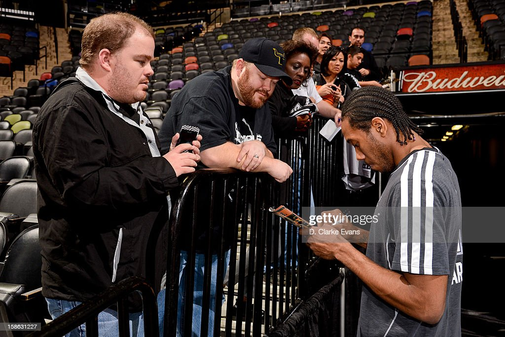 <a gi-track='captionPersonalityLinkClicked' href=/galleries/search?phrase=Kawhi+Leonard&family=editorial&specificpeople=6691012 ng-click='$event.stopPropagation()'>Kawhi Leonard</a> #2 of the San Antonio Spurs signs autographs for fans before a game against the New Orleans Hornets on December 21, 2012 at the AT&T Center in San Antonio, Texas.
