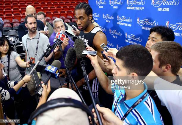 Kawhi Leonard of the San Antonio Spurs speaks to the media after practice on an off day following Game Three of the 2014 NBA Finals against the Miami...