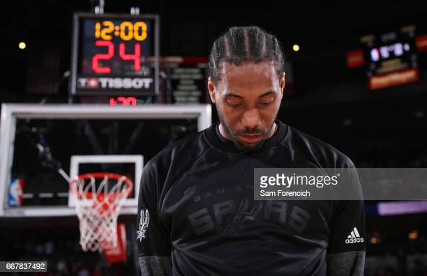 Kawhi Leonard of the San Antonio Spurs stands for the National Anthem before a game against the Portland Trail Blazers on April 10 2017 at the Moda...