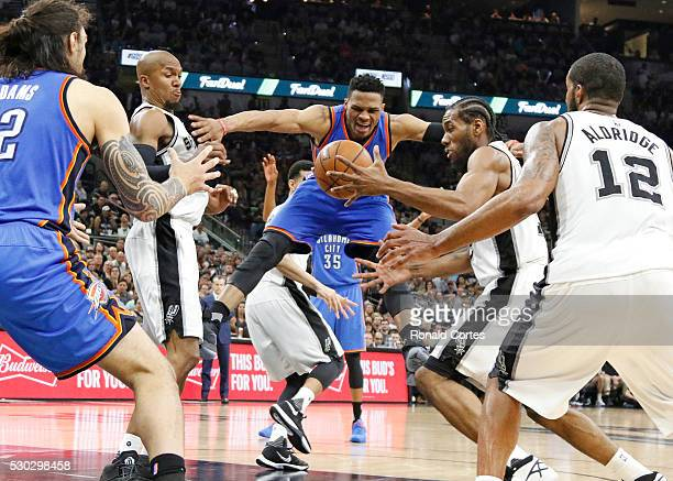 Kawhi Leonard of the San Antonio Spurs strips Russell Westbrook of the Oklahoma City Thunder of the ball in game Five of the Western Conference...