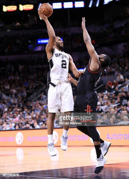 Kawhi Leonard of the San Antonio Spurs takes a shot against James Harden of the Houston Rockets during Game Five of the Western Conference SemiFinals...