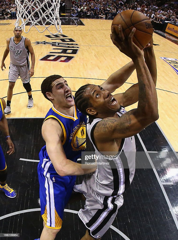 Kawhi Leonard #2 of the San Antonio Spurs takes a shot against Klay Thompson #11 of the Golden State Warriors during Game One of the Western Conference Semifinals of the 2013 NBA Playoffs at AT&T Center on May 6, 2013 in San Antonio, Texas.