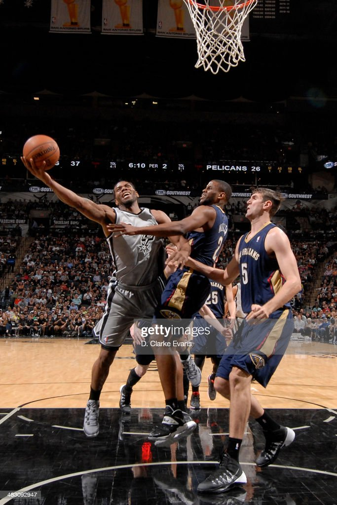<a gi-track='captionPersonalityLinkClicked' href=/galleries/search?phrase=Kawhi+Leonard&family=editorial&specificpeople=6691012 ng-click='$event.stopPropagation()'>Kawhi Leonard</a> #2 of the San Antonio Spurs takes a shot against the New Orleans Pelicans at the AT&T Center on March 29, 2014 in San Antonio, Texas.