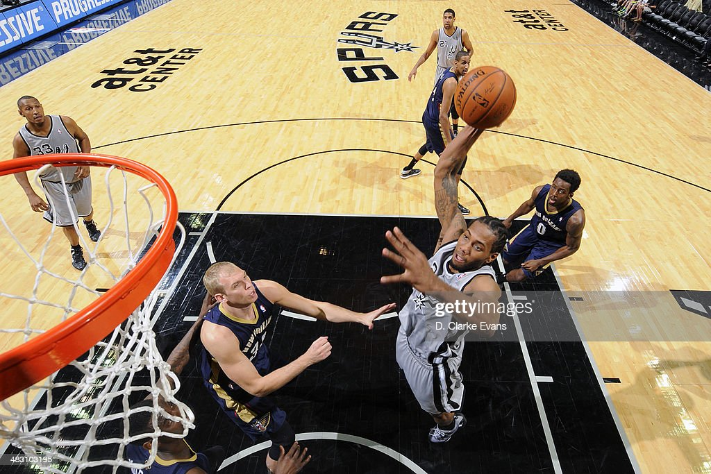 Kawhi Leonard #2 of the San Antonio Spurs takes a shot against the New Orleans Pelicans at the AT&T Center on March 29, 2014 in San Antonio, Texas.