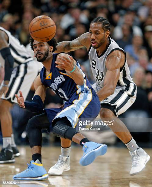Kawhi Leonard of the San Antonio Spurs tries to steal the ball from Mike Conley of the Memphis Grizzlies in Game One of the Western Conference...