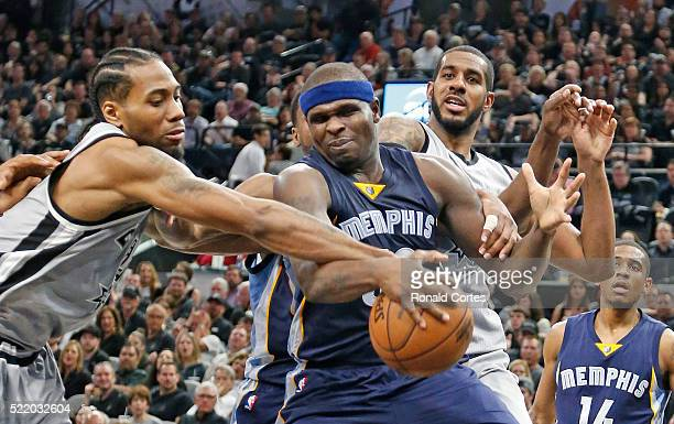 Kawhi Leonard of the San Antonio Spurs tries to strip Zach Randolph of the Memphis Grizzlies of the ball in Game One of the Western Conference...