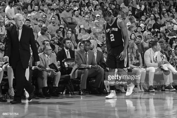 Kawhi Leonard of the San Antonio Spurs walks off the court in Game One of the Western Conference Finals against the Golden State Warriors during the...