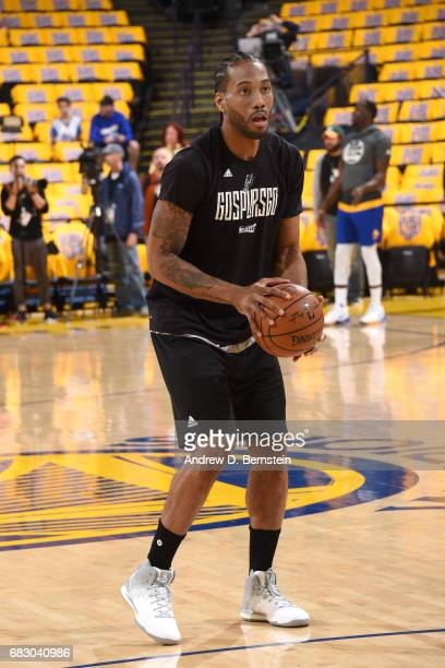 Kawhi Leonard of the San Antonio Spurs warms up before the game against the Golden State Warriors in Game One of the Western Conference Finals of the...