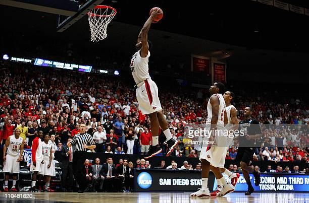 Kawhi Leonard of the San Diego State Aztecs scores the final basket in double overtime against the Temple Owls in the third round of the 2011 NCAA...