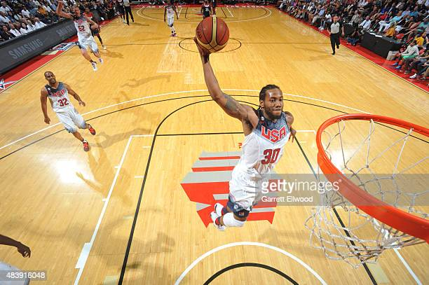 Kawhi Leonard of USA White goes up for a dunk against USA Blue during Team USA Basketball Showcase on August 13 2015 at the Thomas Mack Center in Las...