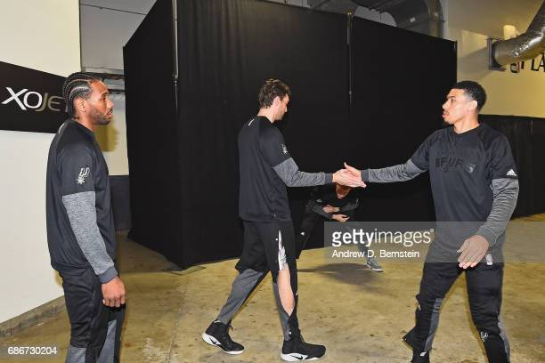 Kawhi Leonard Pau Gasol and Danny Green of the San Antonio Spurs shake hands in the hallway before Game One of the Western Conference Finals against...