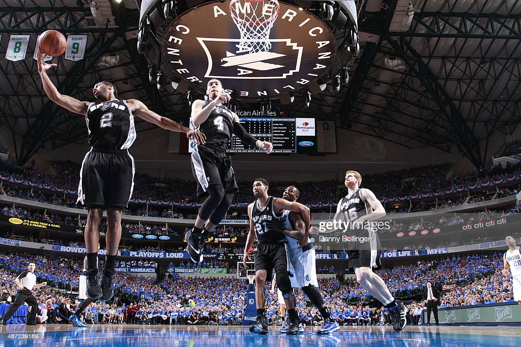 Kawhit Leonard #2 of the San Antonio Spurs grabs a rebound against the Dallas Mavericks in Game Four of the Western Conference Quarterfinals during the 2014 NBA Playoffs on April 28, 2014 at the American Airlines Center in Dallas, Texas.