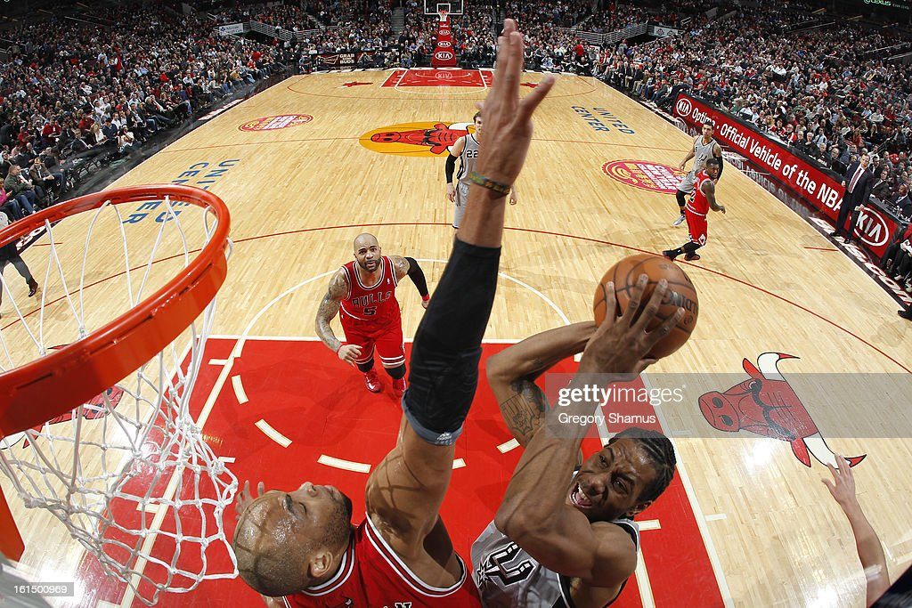Kawhl Leonard #2 of the San Antonio Spurs drives to the basket against <a gi-track='captionPersonalityLinkClicked' href=/galleries/search?phrase=Taj+Gibson&family=editorial&specificpeople=4029461 ng-click='$event.stopPropagation()'>Taj Gibson</a> #22 of the Chicago Bulls on February 11, 2013 at the United Center in Chicago, Illinois.