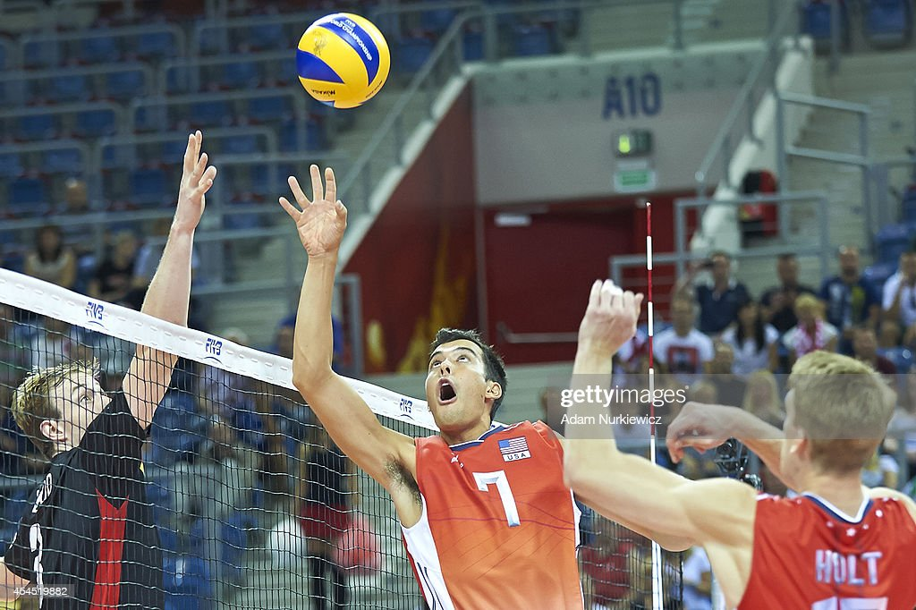 Kawika Shoji of USA (right) attacks during the FIVB World Championships Volleyball at Cracow Arena on August 31, 2014 in Cracow, Poland.