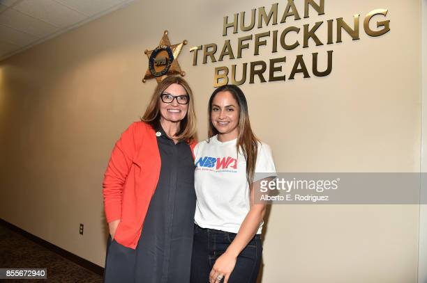 Kay Buck CEO of the Coalition To Abolish Slavery Trafficking and Mia Wright President Director of the National Basketball Wives Association attend a...