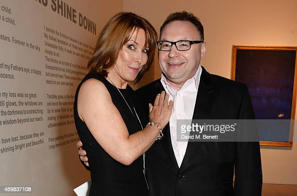 Kay Burley and Jonathan Shalit attend a private view of 'And The Stars Shine Down' by Stasha Palos at the Saatchi Gallery on December 2 2014 in...